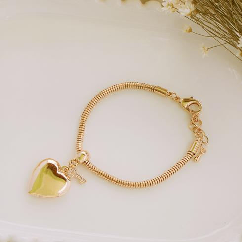 5295-pulseira-coraçao-pigente-ouro-dourado